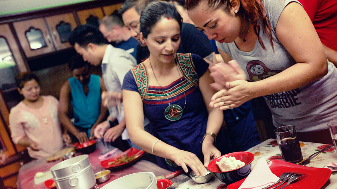 Members of the Sisterhood of Survivors project in Nepal host a dumpling-making class.