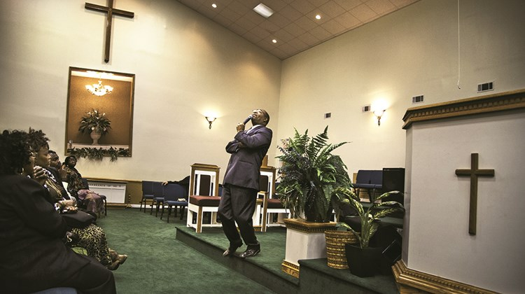 Rev. Virgin Johnson preaches at the Revelation Ministries Church in Sycamore, S.C. &#39;&#39;God sends us a storm. I need this storm. What would I do without my storm? It makes me turn to the Lord. And so I say, &#39;Thank you, storm!&#39;&#39;&#39;<br /><br /><strong>Photo Credit: Steve McCurry/©Steve McCurry</strong>
