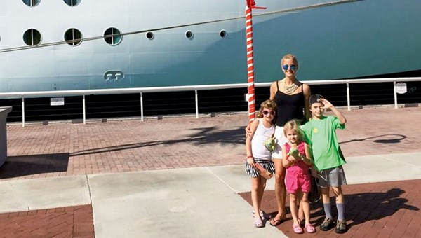Kendra Thornton, the president of Royal Travel & Tours, with her children, Dylan, Karys and Declan.