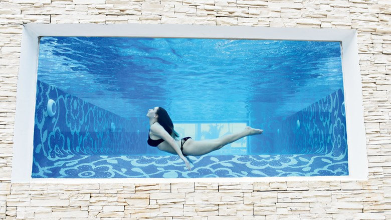 The Mermaid Pool at Chic Punta Cana has a glass viewing wall to watch swimmers go by.