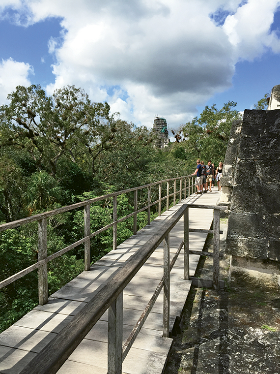 Wooden walkways and stairs protect the ruins from damaging the Mayan archaeological site.