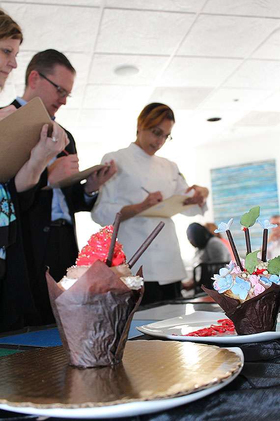 Judges take notes during the cupcake decorating competition at the Tropicana.