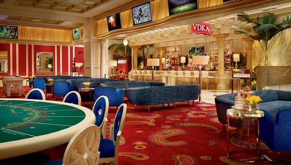 The Encore Players Club at Encore Las Vegas is a multipurpose lounge space separated from the casino that contains gaming, a cocktail bar, complimentary billiards and shuffleboard and touch-screen tables.