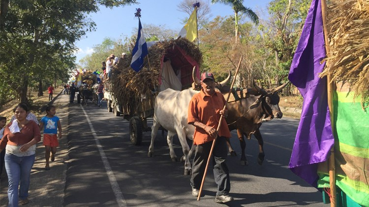 A Semaina Santa procession along a rural road.<br /><br /><strong>Photo Credit: Arnie Weissmann</strong>