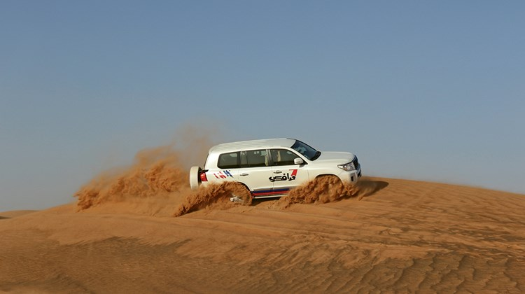 Dune bashing in a Land Cruiser with desert safari operator Travco.