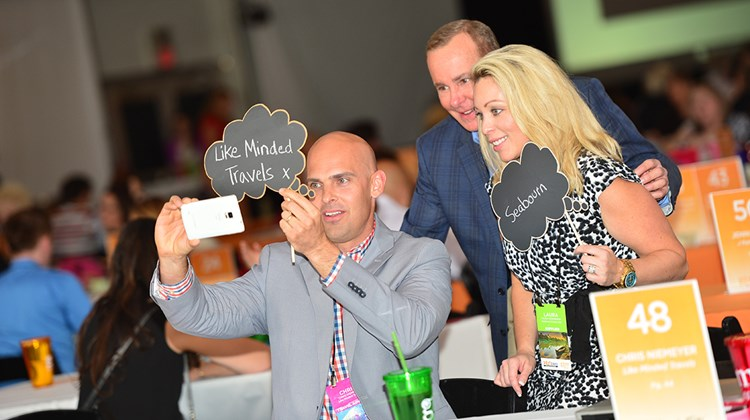 Chris Niemeyer, owner of Like Minded Travels, takes a selfie with Seabourn representatives Doug Seagle and Laura Okonowski during appointments.<br /><br /><strong>Photo Credit: J. Martin Harris Photography</strong>