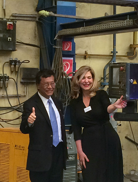Genting Hong Kong CEO Tan Sri Lim Kok Thay and Crystal Cruises CEO Edie Rodriguez celebrate the initial steel-cutting for the first new Crystal river ship on Monday.