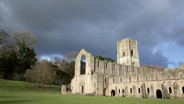 The ruins of Fountains Abbey, a Cistercian abbey shuttered by Henry VIII more than 450 years ago.