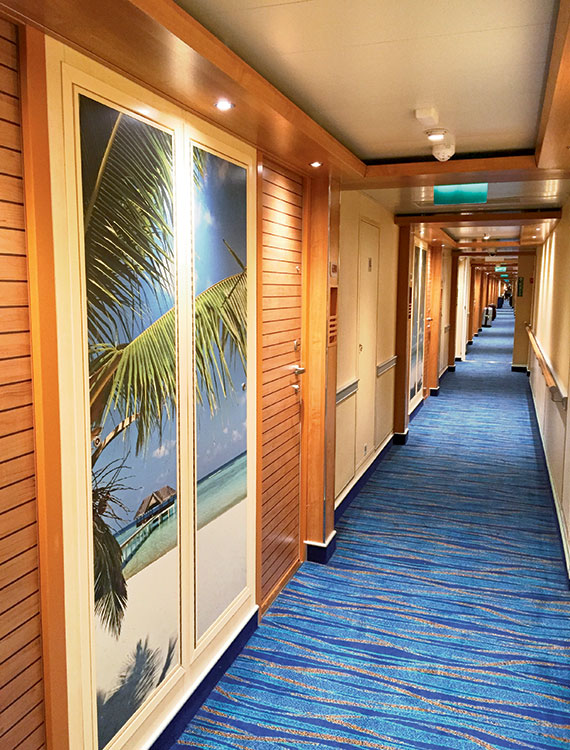 The stateroom corridors on Carnival Vista feature floor-to-ceiling photo panels.