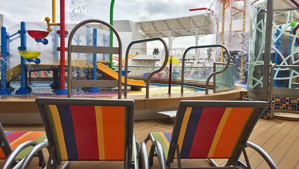 Kid-sized lounge chairs were set up next to the splash park.