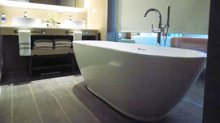 A large soaking tub in the bathroom of a swim-up suite.