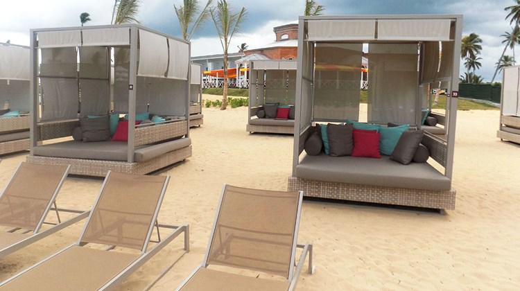 Canopy beds on the golden-sand beach.
