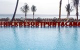 The resort sign at the infinity pool.