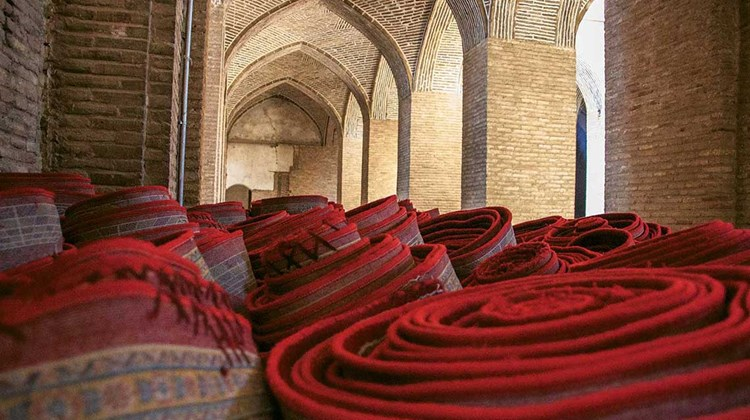 Rolls of beautifully handcrafted Persian rugs were for sale outside Isfahan's bazaar.