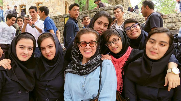 Iranian school groups visiting their country's historic and cultural sites are commonplace. So is their curiosity and warmth, says author Patricia Schultz, surrounded here by a cluster of high school girls who enthusiastically peppered her with questions about life in the U.S.