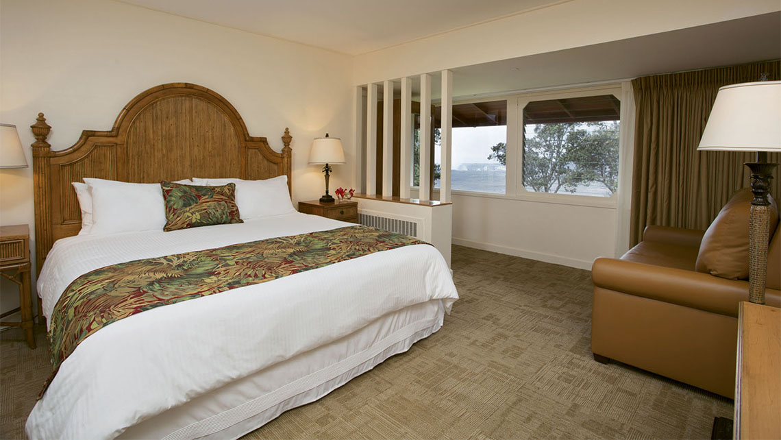 A deluxe room at the Volcano House hotel in Hawaii Volcanoes National Park, with a view of Halemaumau.
