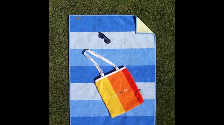 The primary selling points of this unique cotton beach towel are that it is waterproof, which is unique in itself, and ''anti-sand,'' which is supposed to indicate that the product's nylon base backing has ''loop-less'' fibers that sand will not stick to. Pick up the towel from the beach and, according to Sandusa, it will be sand free. In addition, because it is constructed to be waterproof, the beach towel can also be used to wrap your wet gear, protect car seats after a day at the beach or protect electronic gear from a sudden rain storm.