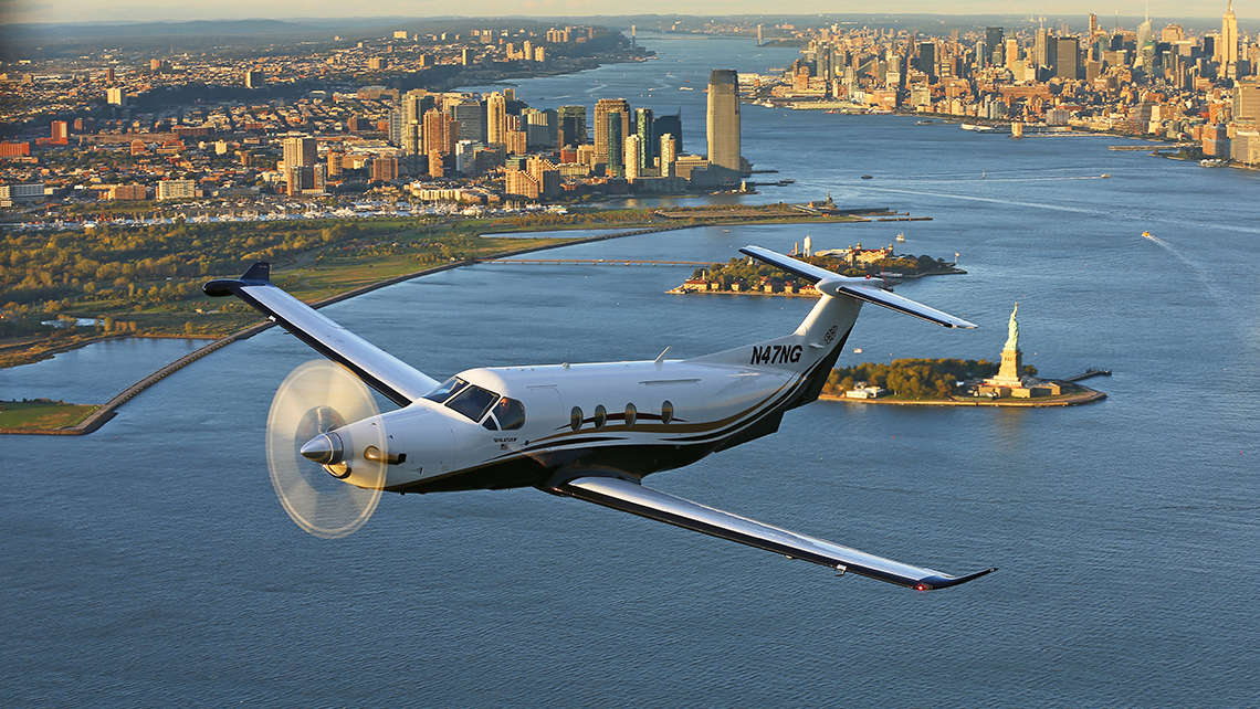 A Tradewind Aviation shuttle, a Pilatus PC-12, soars over New York.
