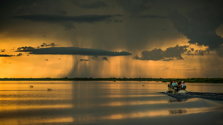 Sunset on the waters in the Pantanal region.<br /><br /><strong>Photo Credit: Mark Edward Harris</strong>