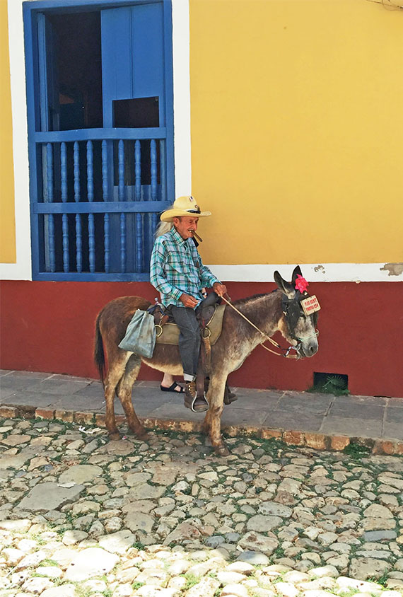 A local man poses for a picture in Trinidad, the only inland excursion during the Celestyal Crystal's Cuba cruise. Photo Credit: Felicity Long