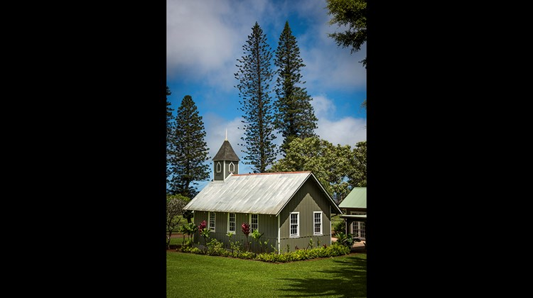 A traditional building on the property of the Four Seasons Resort Lanai, the Lodge at Koele.