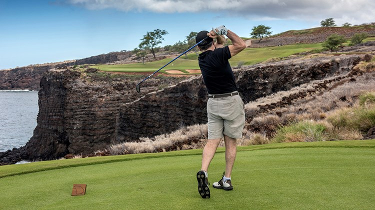 Teeing off on the 12th hole on the Jack Nicklaus-designed Manele Golf Course, an amenity of the Four Seasons Resort Lanai.