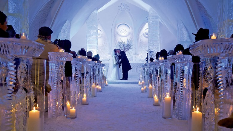 The ice chapel at the Hotel de Glace holds up to 65 guests, providing blankets and wraps as they sit on fur-covered ice pews.