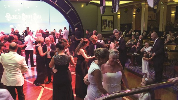 Ballroom dancing is a focal point of evenings on the Queen Mary 2, particularly on themed formal nights, such as black-and-white night. Many passengers head to the Queens Room, which Cunard says offers the largest dance floor at sea.