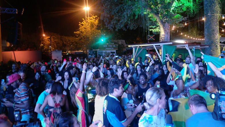 Jubilant fans at Jamaica House in Rio celebrate after Usain Bolt assists the men's 4x100m relay team to victory.
