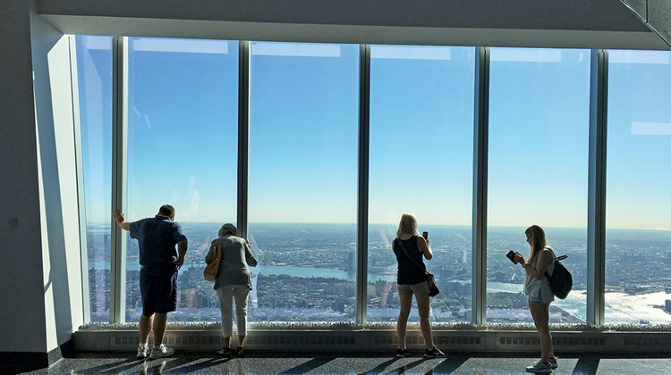Tourists take in the view from the observatory at One World Trade Center.