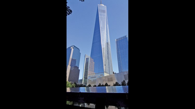 One World Trade Center, which opened in November 2014, with the September 11 Memorial in front of it.