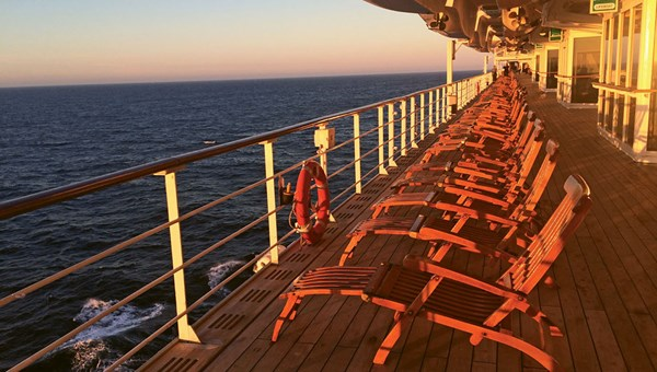 The QM2 includes a wraparound promenade with teak decking and comfortable chairs. It is sometimes too chilly and wet to enjoy the ship's open decks, but on this trip the sky cleared and passengers were treated to a magnificent sunset.