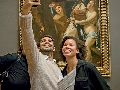 Group members take a selfie during a scavenger hunt that's part of a Museum Hack tour.