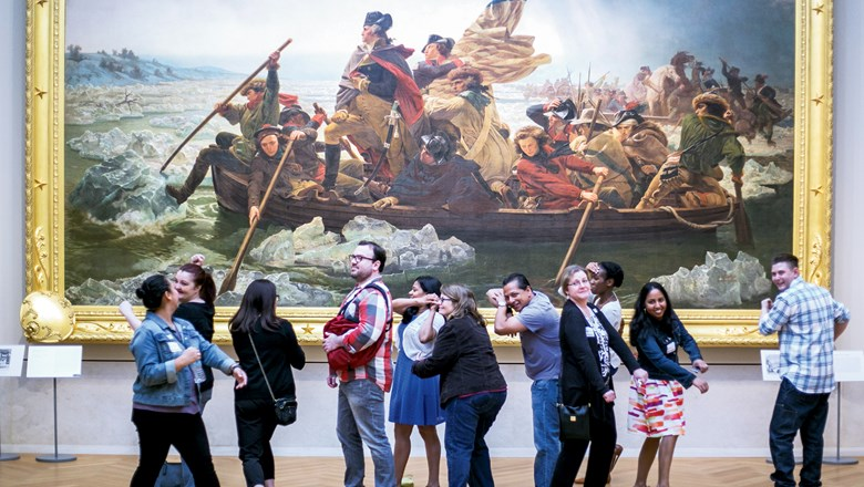 "A Museum Hack tour group re-enacts the painting ""Washington Crossing the Delaware"" at New York's Metropolitan Museum of Art."