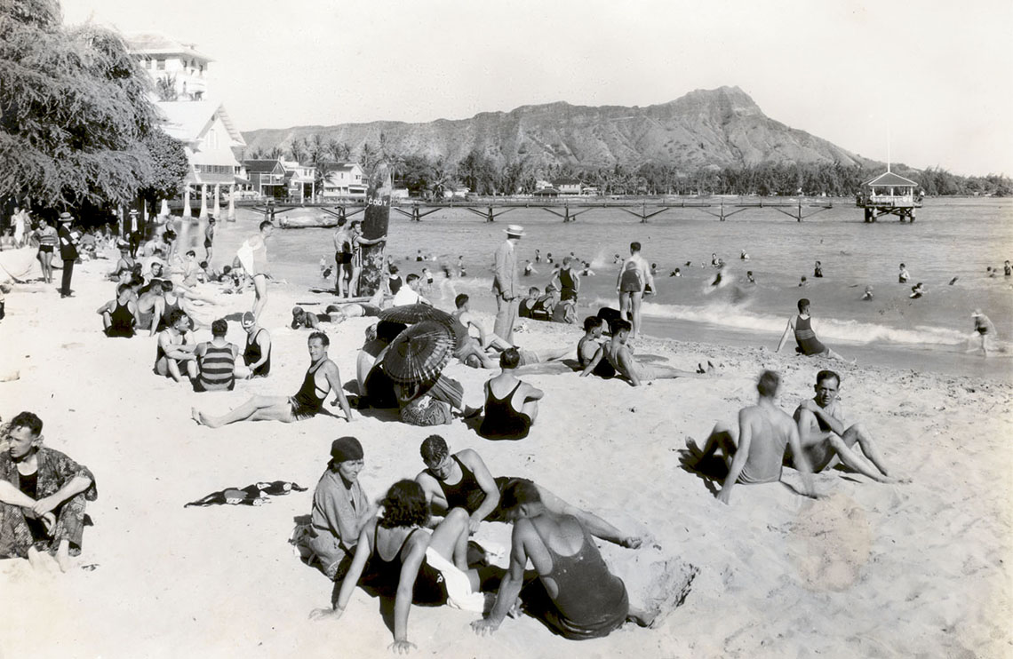 Waikiki beachgoers relax near the Moana Surfrider, around 1925.