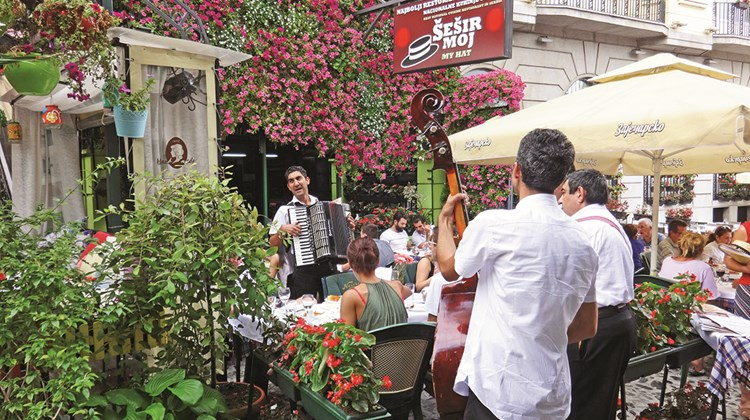 Serbians and tourists alike enjoy traditional national cuisine and Roma music on a Sunday afternoon along the pedestrian Skadarlija Street in Belgrade&#39;s old town.<br /><br /><strong>Photo Credit: Robert Silk</strong>