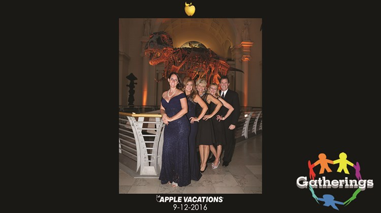 Guests at Apple Vacations' Golden Apple Awards and Crystal Awards gala posed in front of Sue, the Tyrannosaurus rex skeleton at Chicago's Field Museum. From left, April Wickey, Apple Vacations; Karen Spinelli, Apple Vacations; Deb Hofer, Apple Vacations; Teresa Nichols, Apple Vacations; and Richard Rodriguez, Alsol Hotels & Resorts.