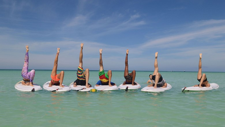 A popular fitness activity offered to guests at the Aruba Marriott Resort & Stellaris Casino is stand-up paddleboard yoga in the waters off Palm Beach.
