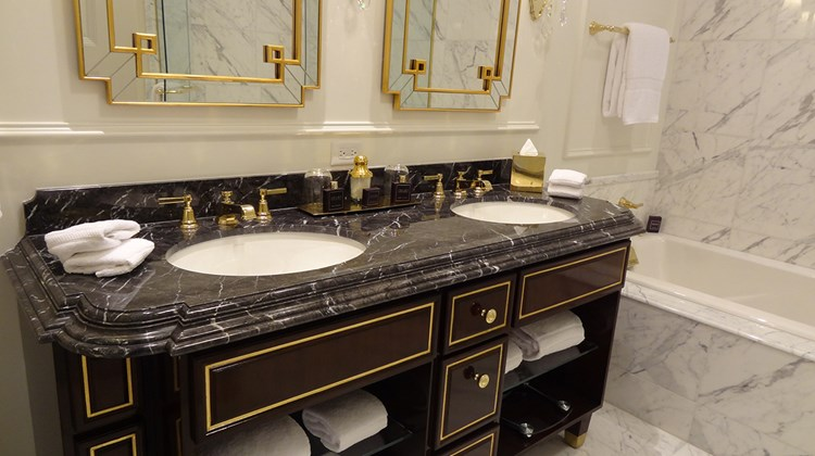 Guestroom bathrooms feature Italian marble and brass fixtures.