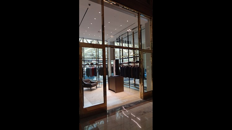 One end of the hotel's atrium lobby houses Washington's first Brioni menswear shop.