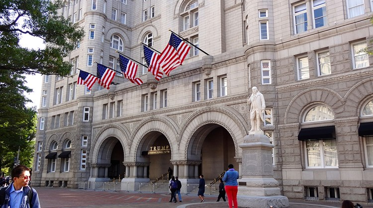 The facade of the Trump International Hotel Washington, D.C., which has a statue of Benjamin Franklin in front.