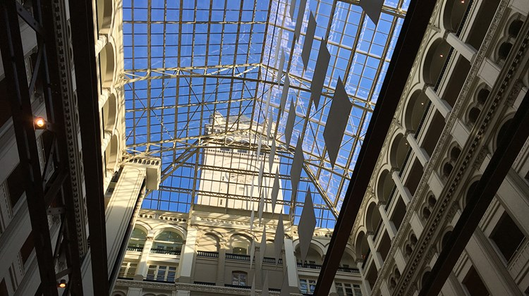 A view of the nine-story atrium's glass ceiling and its iconic tower housing the Bells of Congress, making the hotel the second-tallest structure in the capital, after the Washington Monument.