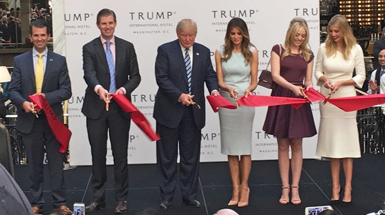 Donald Trump and his family officially opened the Trump International Hotel Washington, D.C. with an Oct, 26 ribbon-cutting ceremony. At the ceremony commemorating the official opening, the Republican presidential nominee was flanked by sons Don Jr. and Eric, and wife Melania, and daughters Tiffany and Ivanka.