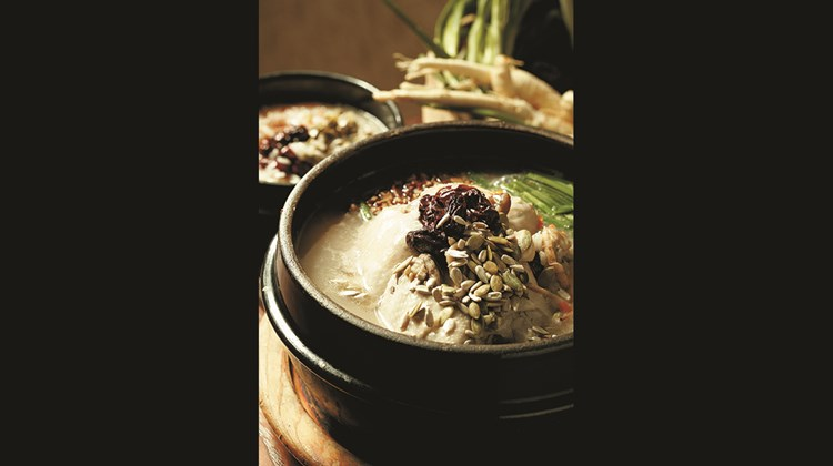 Chicken porridge, or dakjuk, is a Korean dish made with chicken, rice, garlic and green onions.<br /><br /><strong>Photo Credit: Korea Tourism Organization</strong>