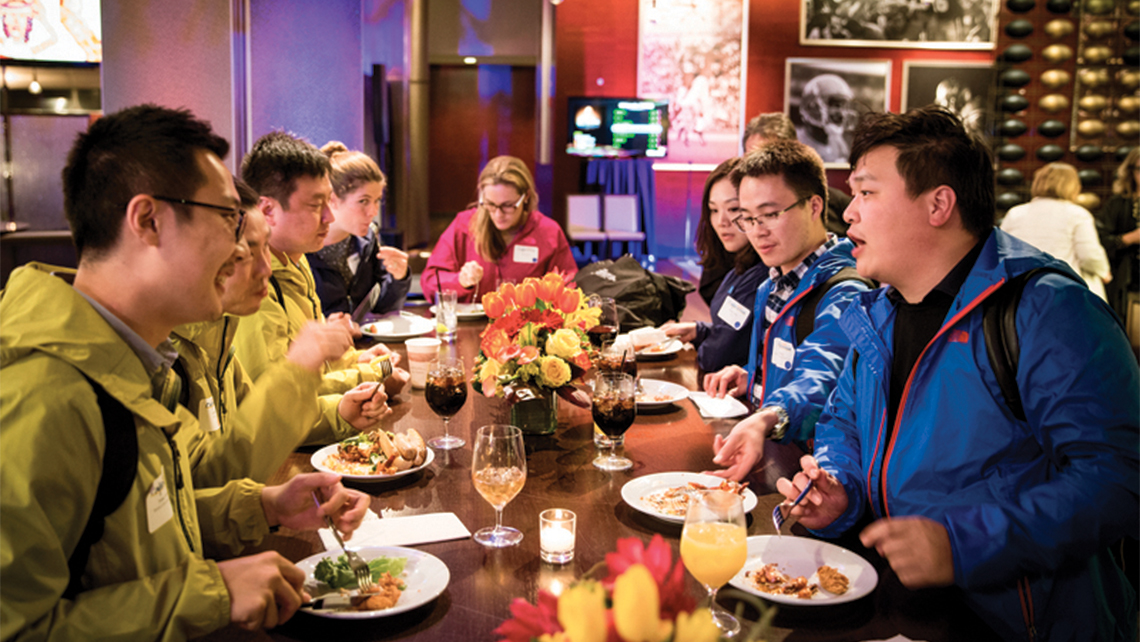 Chinese tour operators swap U.S. travel stories at a mega-fam dinner hosted by Brand USA.