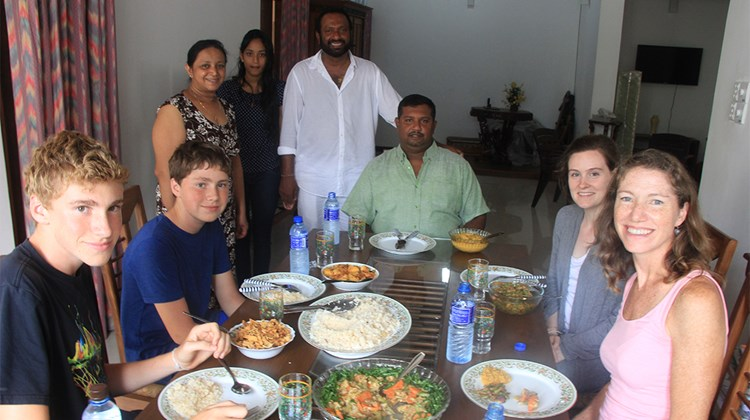 Editor in chief Arnie Weissmann and his family were invited to have lunch at the Colombo home of his guide, Sudesh Wickramaratna. Seated at the head of the table is Thusha, the driver for the tour.<br /><br /><strong>Photo Credit: Arnie Weissmann</strong>
