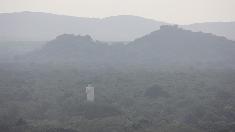 A view in one direction from the top of Sigiriya Fortress reveals a giant Buddha in the forest.<br /><br /><strong>Photo Credit: Arnie Weissmann</strong>