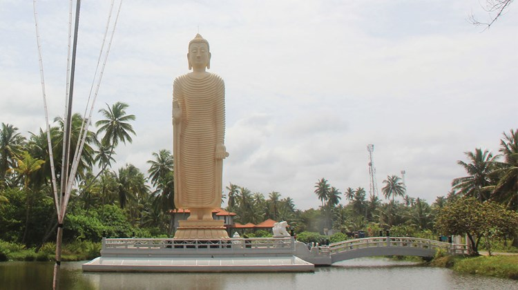 A Japanese-funded memorial to the 2004 tsunami which killed 30,000 Sri Lankans. The Buddha is a replica of one of the Bamiyan Buddhas destroyed by the Taliban in Afghanistan.<br /><br /><strong>Photo Credit: Arnie Weissmann</strong>