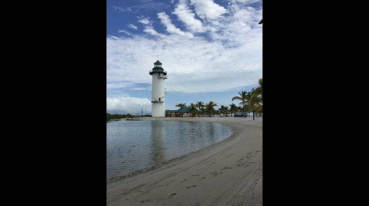 The Harvest Caye Flighthouse overlooks the recreation lagoon.
