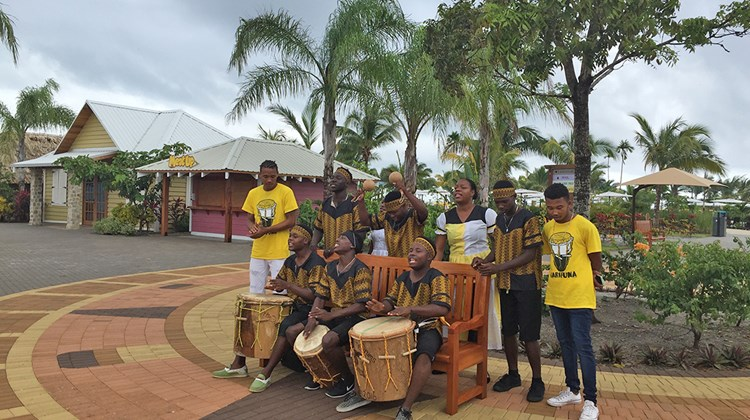 Norwegian Cruise Line spent 31 months building Harvest Caye, a 55-acre private port attraction in southern Belize. When passengers arrive onshore they are greeted by an Afro-Caribbean band playing drums and percussion instruments and singing songs native to the Garifuna, an ethnic sub-group in Belize.